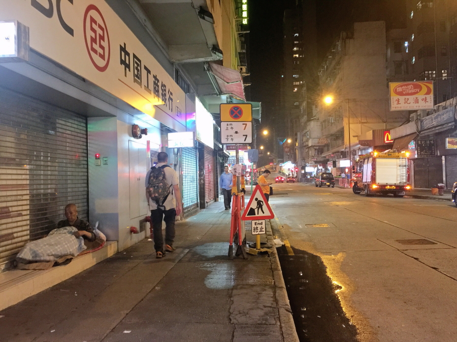 Homeless man on the Queen's Road West road, Hong Kong