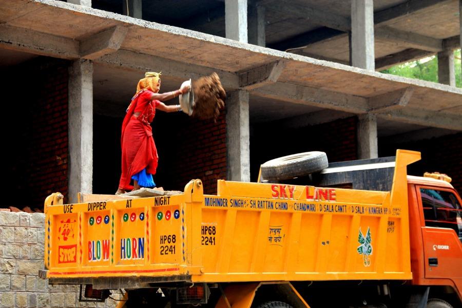 Woman construction worker at McLeod Ganj, Dharamsala, India
