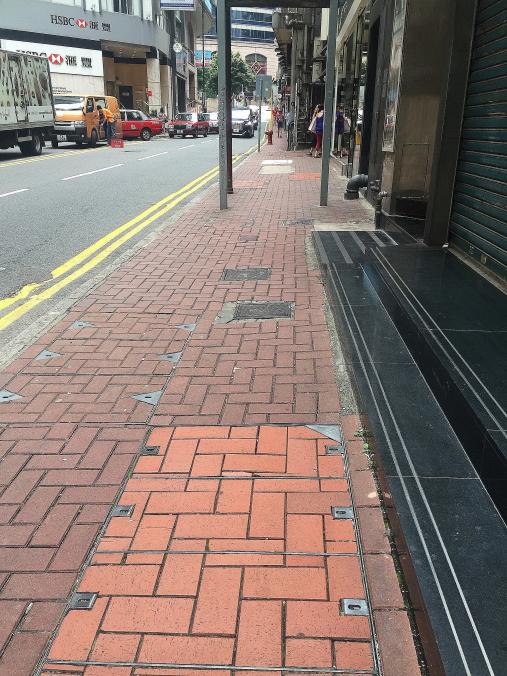 Manhole on pedestrian walkway, Hong Kong