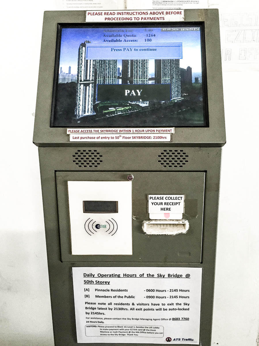 Payment machine where you can purchase ticket to go to Sky Bridge / Sky Garden at Level 50. You can only pay with EZ-Link with this machine. If you need to pay by cash, inform the officer in MA Office. Opening hour information is clearly pasted on the machine.