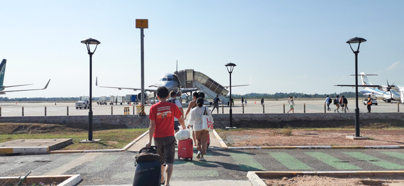 Flying out of Siem Reap Airport - walk across runway to the plane